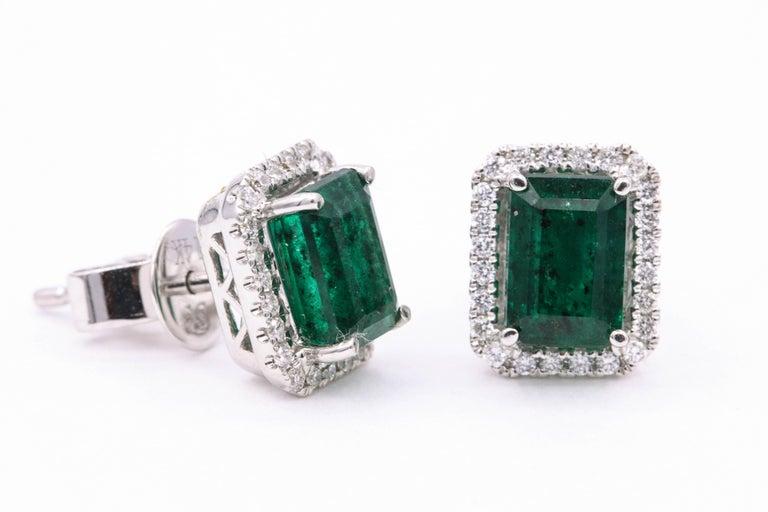 Contemporary Emerald Diamond Halo Stud Earrings 2.52 Carat 14 Karat White Gold For Sale