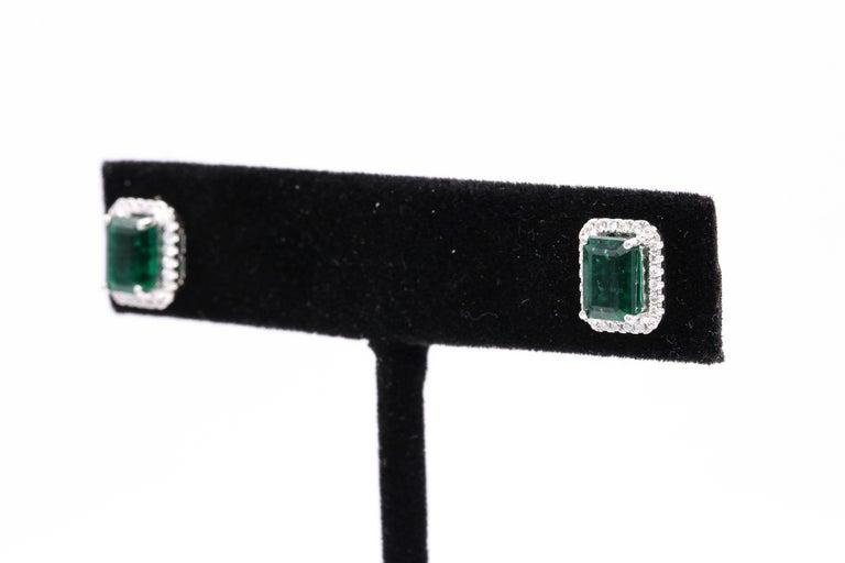Emerald Diamond Halo Stud Earrings 2.52 Carat 14 Karat White Gold For Sale 1