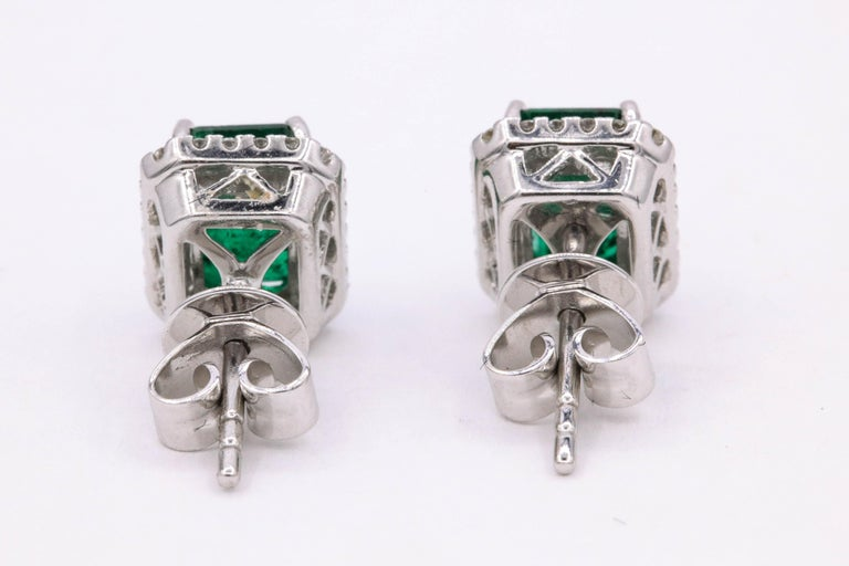 Emerald Diamond Halo Stud Earrings 2.52 Carat 14 Karat White Gold For Sale 3