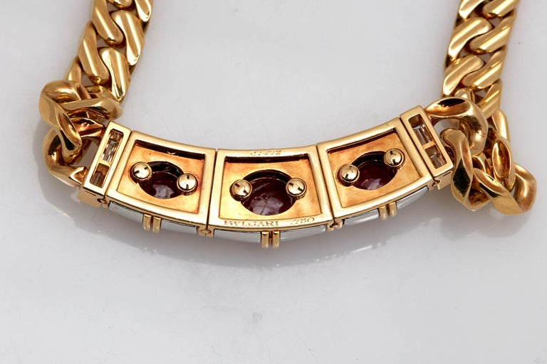 A rare Bulgari chain necklace in 18kt yellow and white gold, accented with diamonds, showcasing three natural no-heat Burma rubies (app. 9crts total). Made in Italy, circa 1970