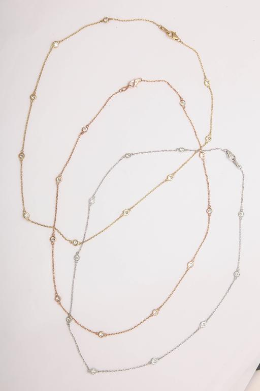 These necklaces are available in 14 kt yellow, white or rose gold. There are 10  diamonds  in each necklace averaging 1.10 cts. The quality of the diamonds is G-H color, SI 2 clarity. All necklaces are 18 in. and priced at $2275.00 each.