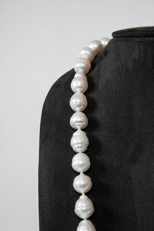 This Baroque Necklace  has 49 Beautiful Pearls  ranging from 13 mm to 18 mm Opera length 34