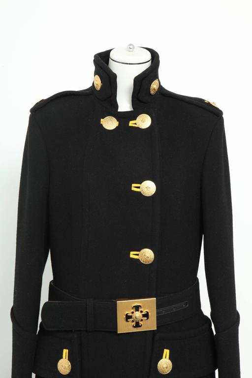 From one of Donatella Versace's best collections, beautiful black wool coat with Medusa buttons and a belt. A runway piece. Size is IT 44 but fits slightly small, about US 4-6.