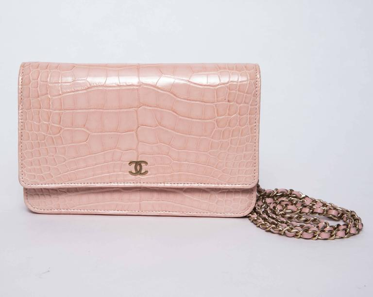 Chanel Blush pink Alligator Chanel Wallet On Chain features gold tone hardware, single shoulder strap with chain link cross-body strap and CC logo at front. Single pocket at interior wall with zip closure,  pocket at flap with zip closure,  three