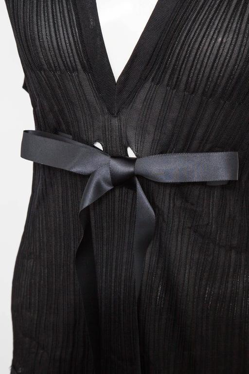 Gorgeous Chanel black knit top with black satin bow. French size 44.
