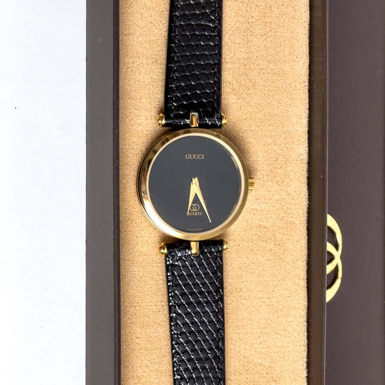e39c0584280c5 Vintage Gucci Women's Black and Gold Tone Reptile Band Watch
