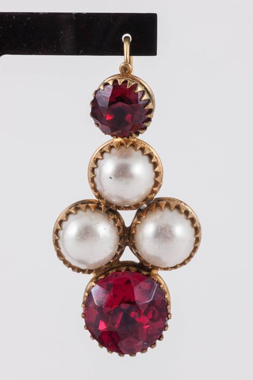 These earrings must have been the sort of things Chanel had in mind when she started to design pieces with Maison Gripoix. Possibly theatrical,these however are much much earlier than Chanel,probably around 1830. The construction is interesting, the
