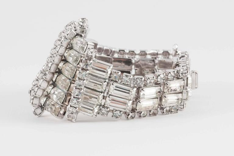 This wonderfully designed bracelet makes a strong statement. Probably designed to be worn over gloves, it is a good size for even a bigger wrist, and is ready for the party season. It has a working safety chain so you won't lose it!