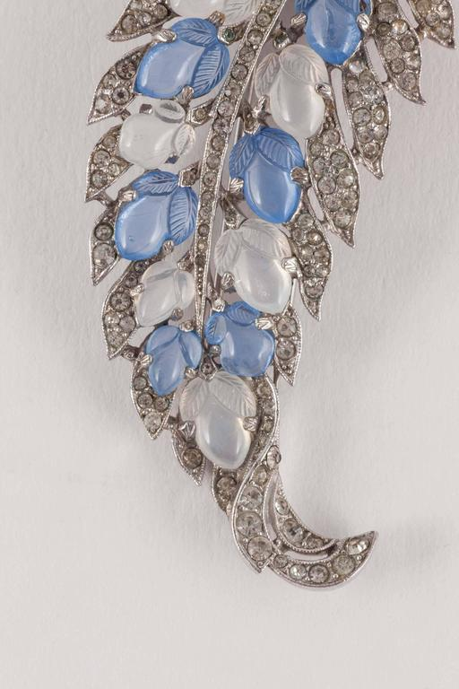 Elegant , stylised brooch (with fur clip fitting) in the form of a 'leaf' , set with 'fruit salad' moulded glass stones, in moonstone and blue chalcedony glass, and paste. Based on iconic Cartier jewels from the 1930s, the Trifari 'fruit salad'