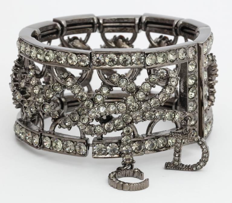 Beautiful Christian Dior by John Galliano bangle with bow and rhinestones. Adjustable, one size fits all.