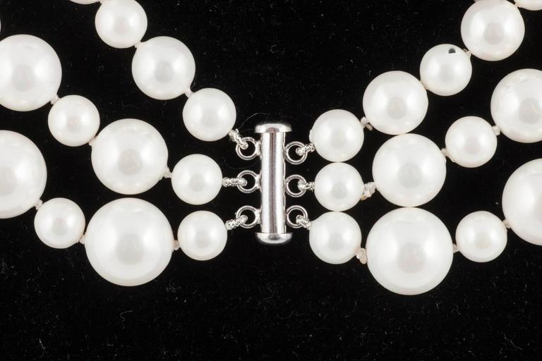 Classic 3 row pearl necklace, with matching drop earrings, 1990s For Sale 1