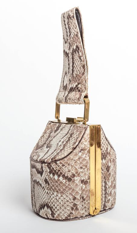 Stunning architectural vintage box handbag in genuine python with brass hardware in the style of Bienen Davis. This bag is lined in leather and features two deep compartments with a center compartment containing its original beveled two sided