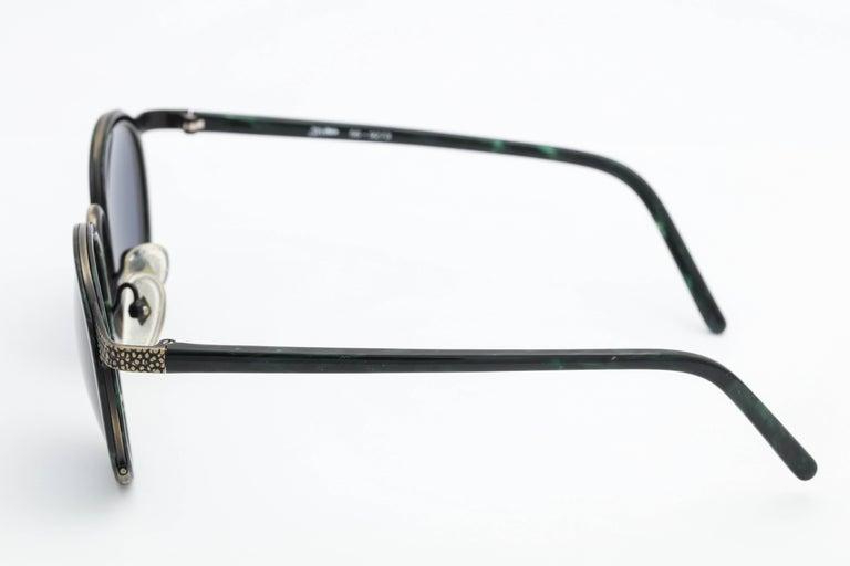 Green/Black Vintage Jean Paul Gaultier Sunglasses  Frame Width: 150mm  Lens Width: 51mm  Frame Height: 54mm  Arm Length: 124mm