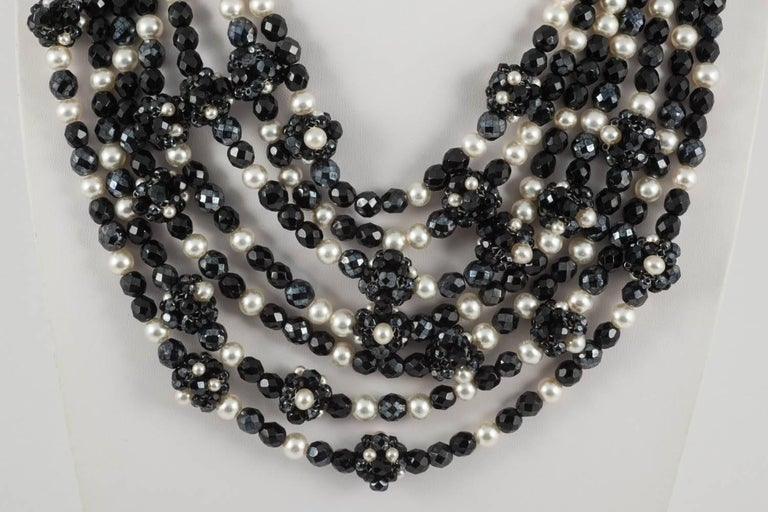An important and statement seven row necklace from Coppola e Toppo, Milan, made with their signature bead encrusted clasp, and the unusual element of handwoven beaded 'balls' interspersed through the rows, also made of black beads and pearls. A