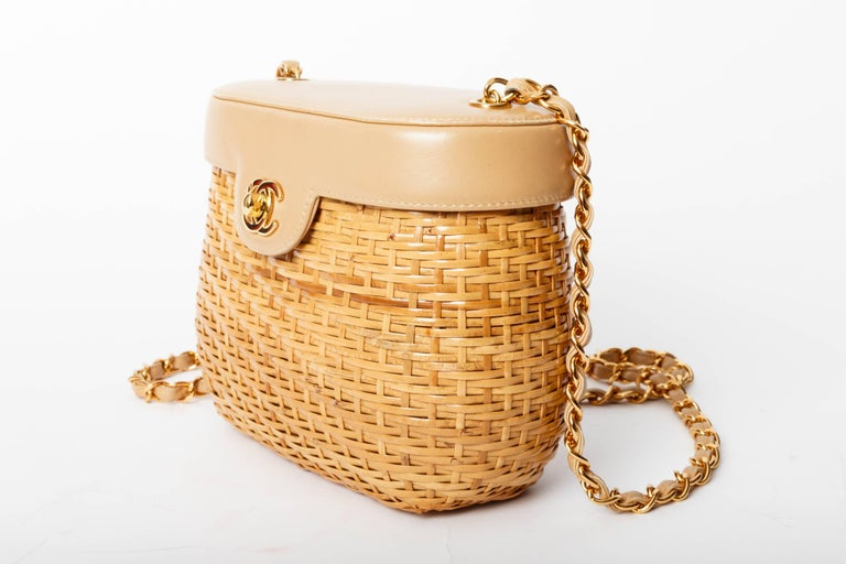 Fabulous CHANEL Vintage Tan Lambskin and Straw Bag with Gold Hardware.  Features a gold chain shoulder strap with gold Chanel CC Mademoiselle turn lock.  Condition is excellent. There is no hologram or accompanying authenticity card with this piece