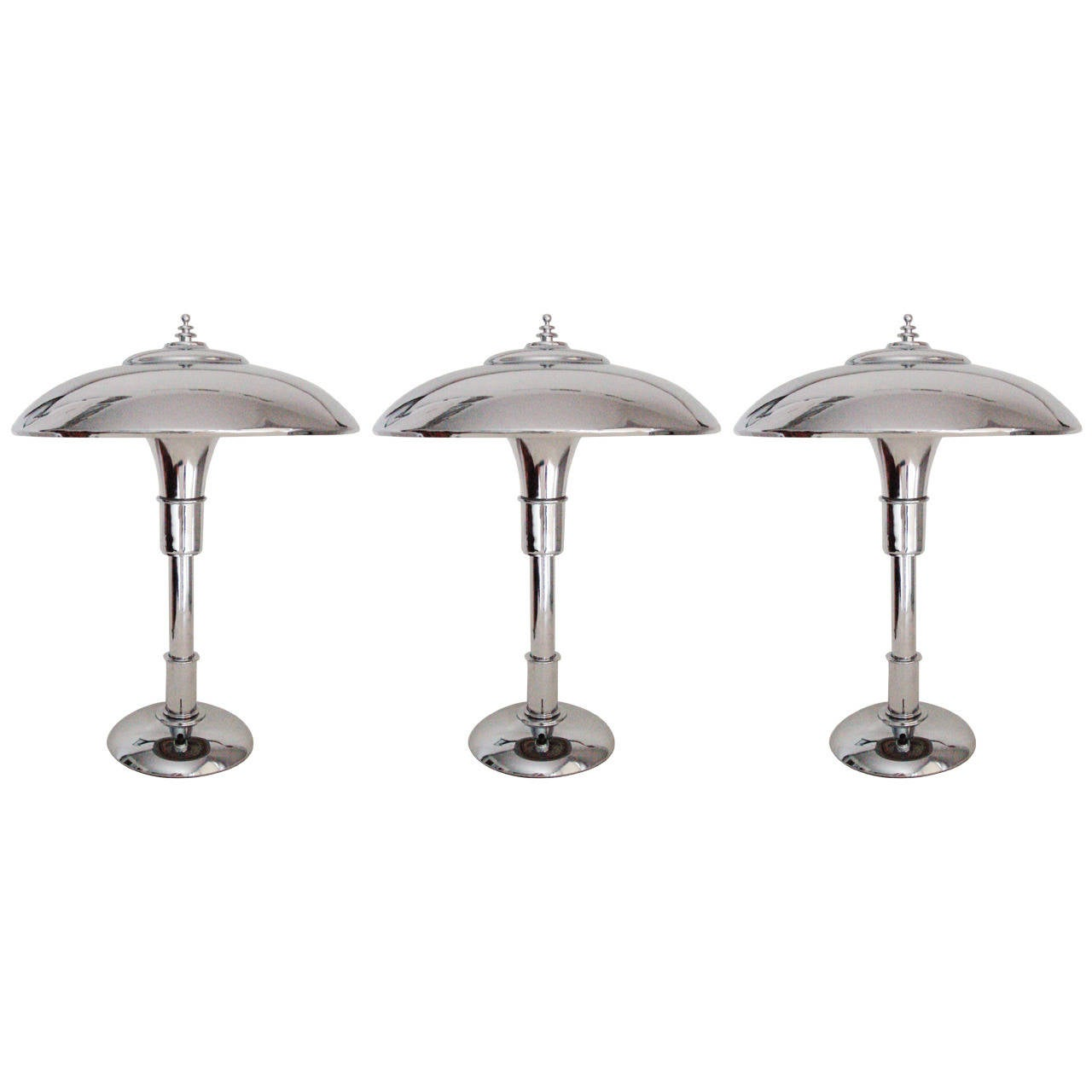 Three iconic american art deco chrome plated guardsman for Iconic design lamps
