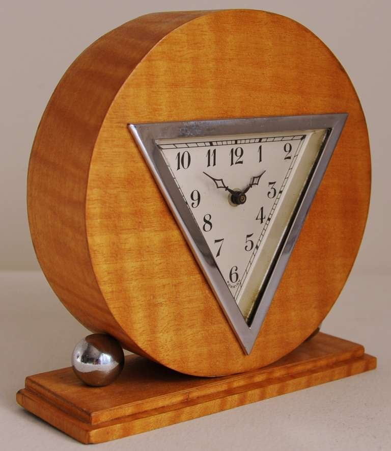 This German Art Deco chrome and striped blonde veneered table clock is a veritable riot of geometric shapes! It is marked 'Foreign' just below the '6' on the dial signifying a clock exported from Germany to England between the wars.