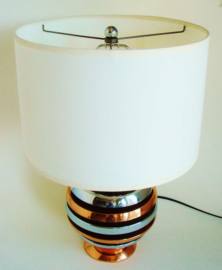 This spherical American Art Deco or Machine Age table lamp is constructed from alternating layers of chrome plated metal and copper. It is in excellent original condition but has been rewired. For ease of shipping it can be supplied with or without