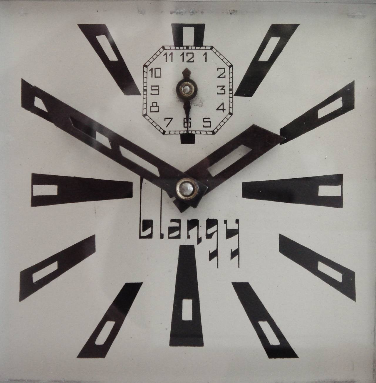 This is one fine looking ultra Art Deco styled French alarm clock from its radical flat chrome fretted front panel to the typographical design triumph of its numerals and hands. Even the wordmark of the manufacturer, Blangy, is extreme in its style