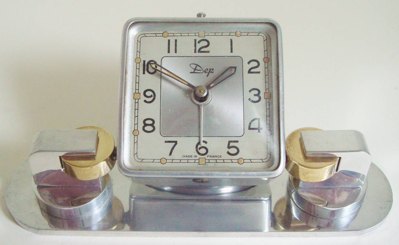 Art deco french aluminium and brass mechanical tilt alarm Art deco alarm clocks