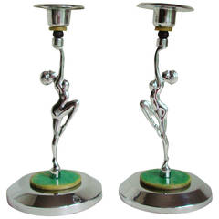 Pair of English Art Deco Chrome & Bakelite Bookended Nude Candlesticks.