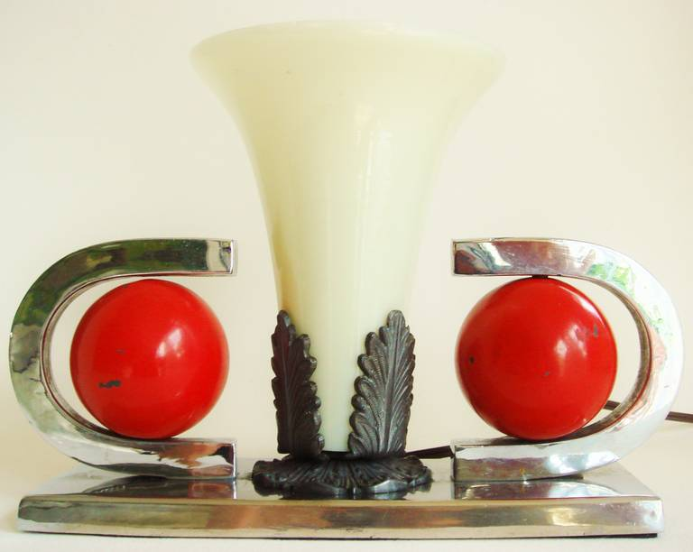 This American Art Deco geometric table lamp/torchiere is extremely heavy as, like the matching designed bookends that were produced by the same anonymous company, the two spheres are filled with lead shot. The nickel plating and bronze wash shade