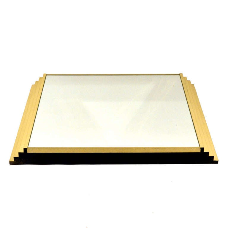 Mirror with descending steps at the sides. Ideal over a console or fireplace.