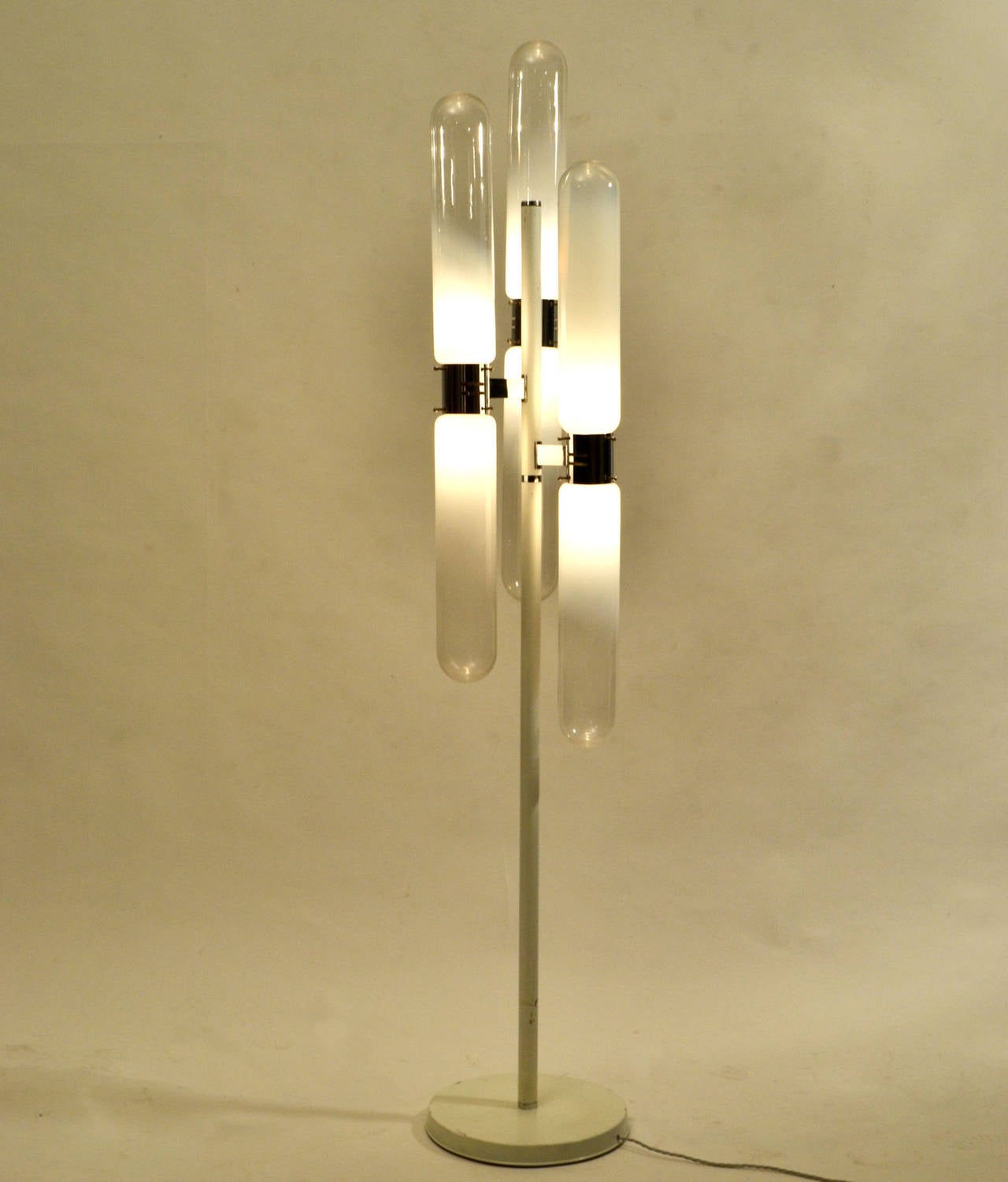 Floor lamp with six hand blown tube shades connected upwards and downwards to the center frame in chrome and white metal. The glass is colored from milk white fading to translucent and to a clear diffused the light.