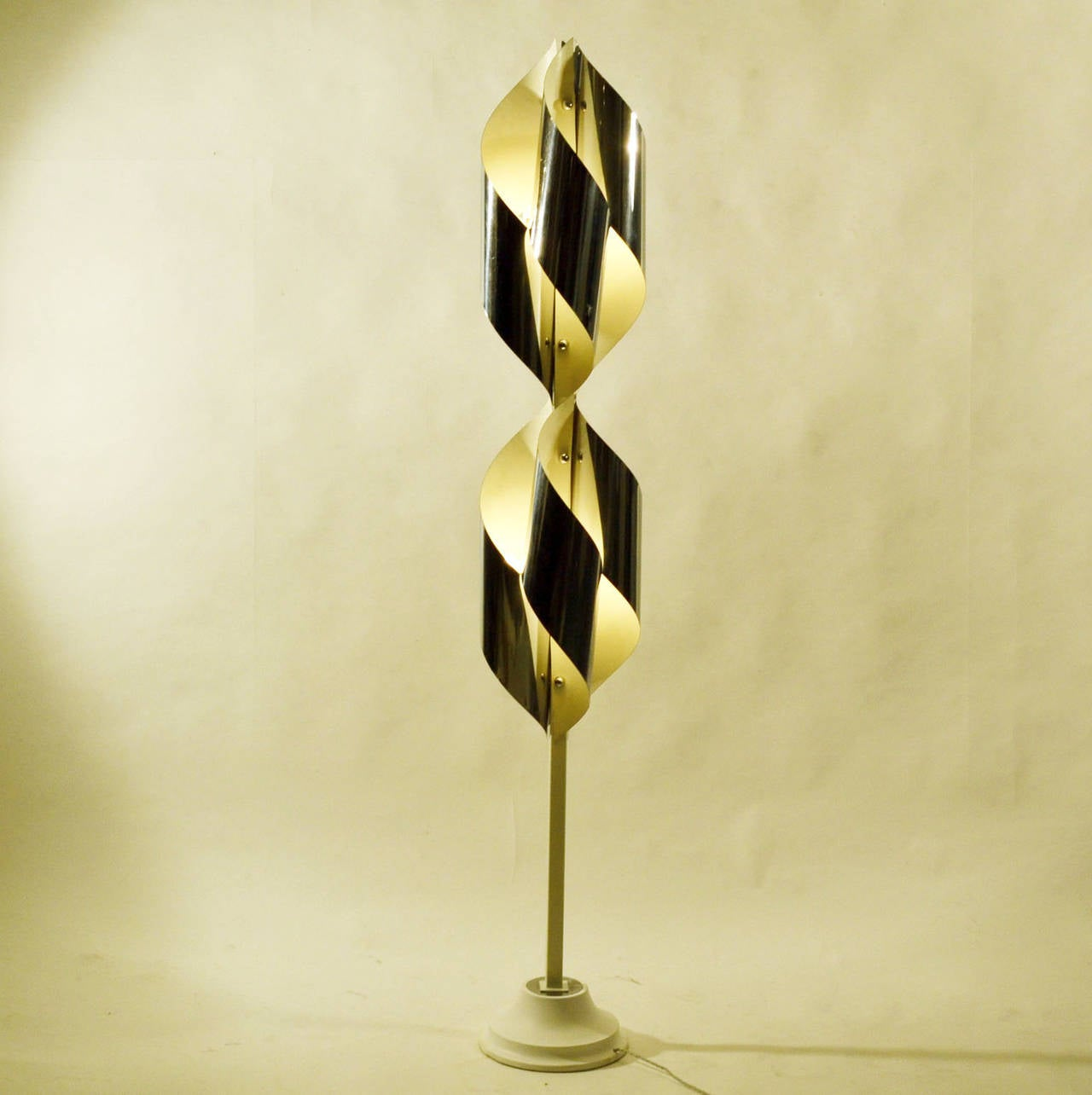 Twisted chromed sheet metal shaped in an array around the center stem. The lamp has eight lights.