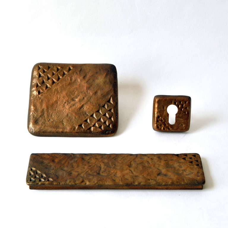 Cast bronze door handle, letter box and key holder with surface markings reminiscent of the Stone Age cave drawings.  Full dimensions: The door handle Width 5.9 x 5.91 in./ 15 x 15 cm Depth 2.36 in./ 6 cm The letter box; Width 10.24 in. /26