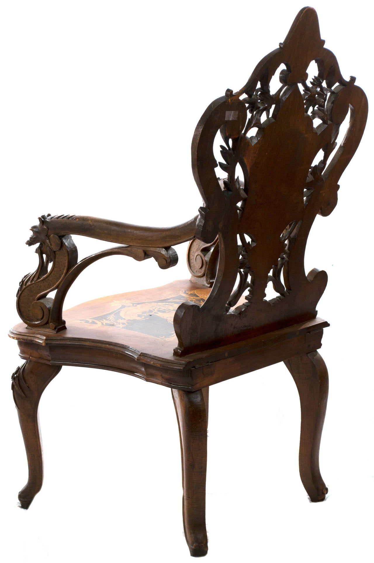 A Late Nineteenth Century, Black Forest Arm Chair With Elaborately Carved  Back