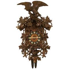 A Large Black Forest Linden Wood Cuckoo Clock