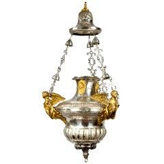 A large gilt censer chandelier with sculpted angels