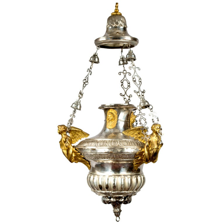 A large gilt censer chandelier with sculpted angels