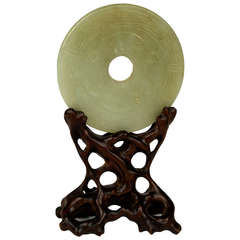 Carved and Pierced Celadon Jade Disc on Stand