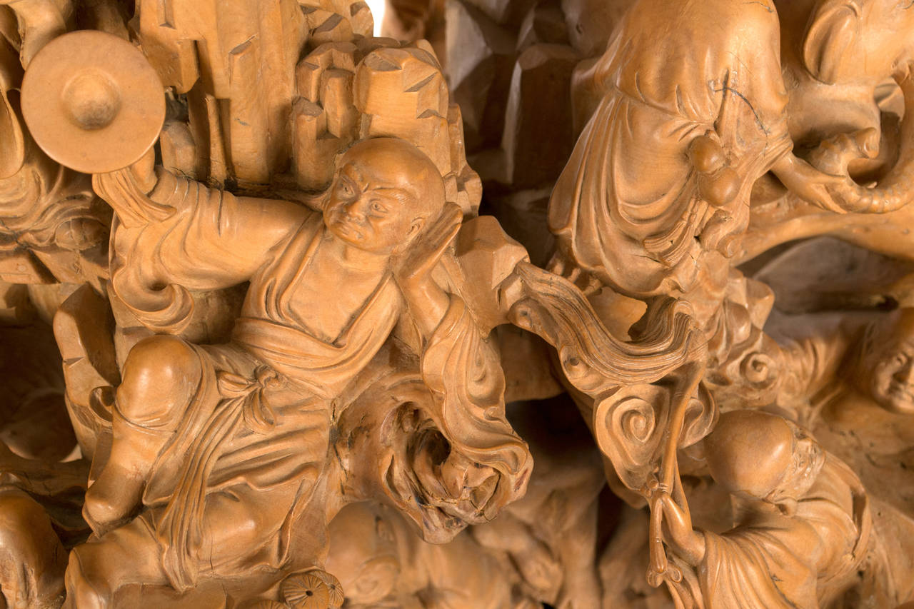 Chinese boxwood sculpture depicting the eighteen lohan for