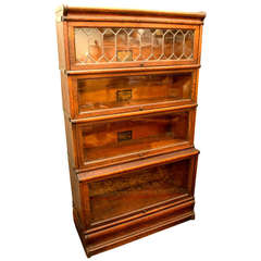 An Arts & Crafts oak barrister bookcase by Globe Wernicke