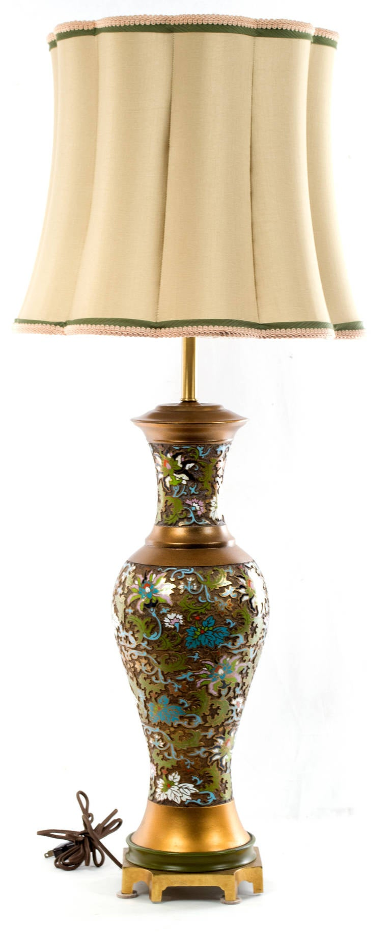 A gilt bronze cloisonné lamp topped with an embroidered silk shade, made in China during the middle of 20th century.