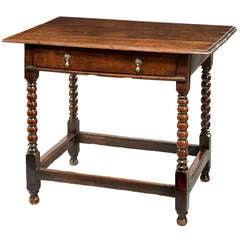 A 17th Century oak table.
