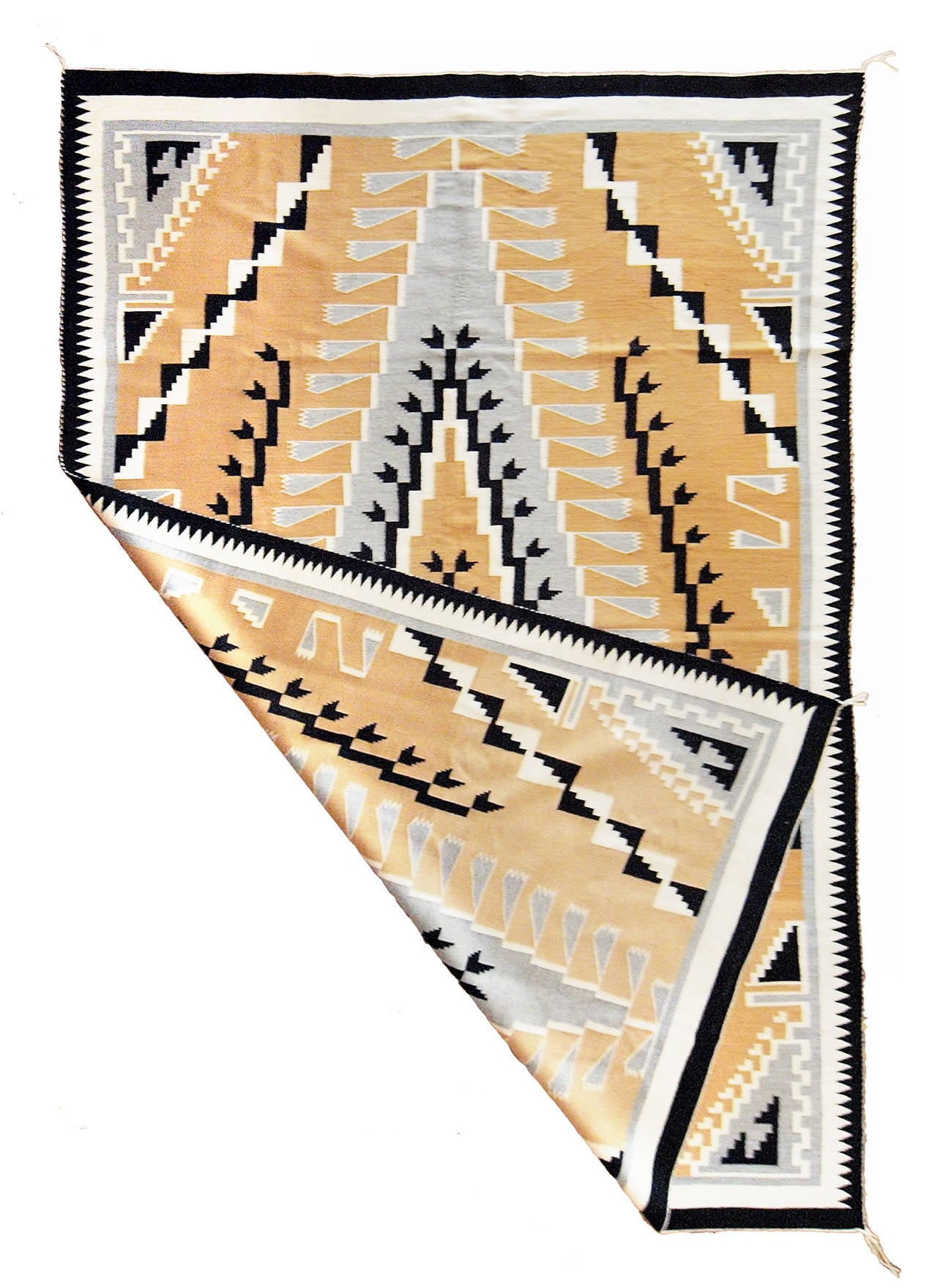 A large area rug with aCrystal Trading Post design. Woven of native hand-spun wool in natural fleece colors of gray, ivory, black and camel/beige.  This textile is well suited for use on the floor as an area rug, as a wall hanging or furniture