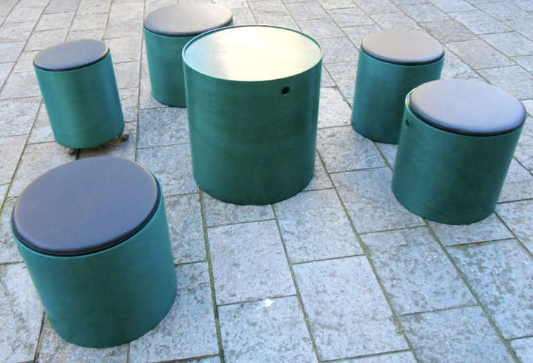 Six large cylindrical elements of different sizes made of plywood, which can be fitted into one another. There is a bar section on casters and five seating elements.  Designed in 1965 and made by Sommer/Germany .
