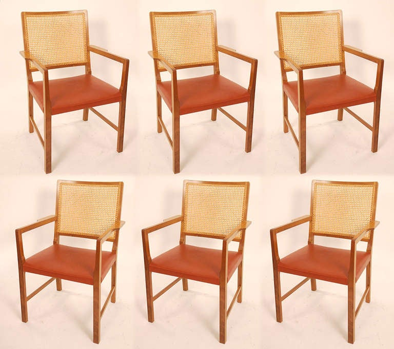 Six arm chairs designed by Bernt Petersen and edited in 1960s by Rud Rasmussen. Mahogany frame, woven cane and original red leather. Excellent condition.
