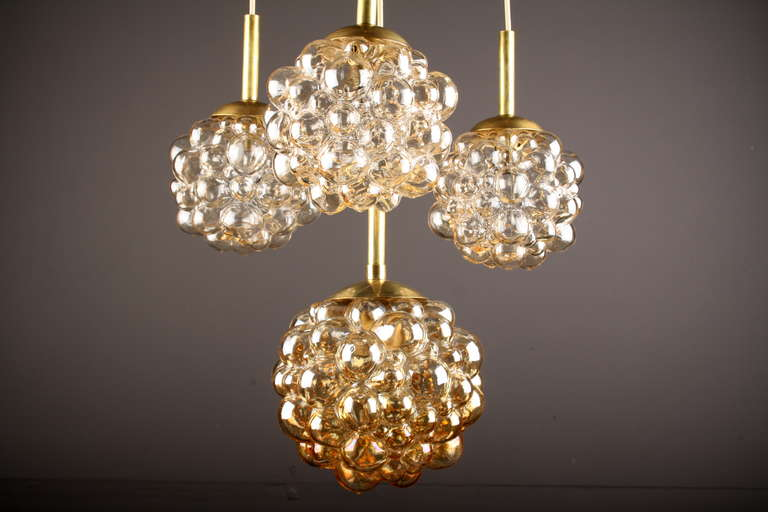 Four bubble pendants limburg light chandelier circa 1960s at 1stdibs impressive brass and amber toned glass bubble globe four pendants chandelier with thick aloadofball Image collections