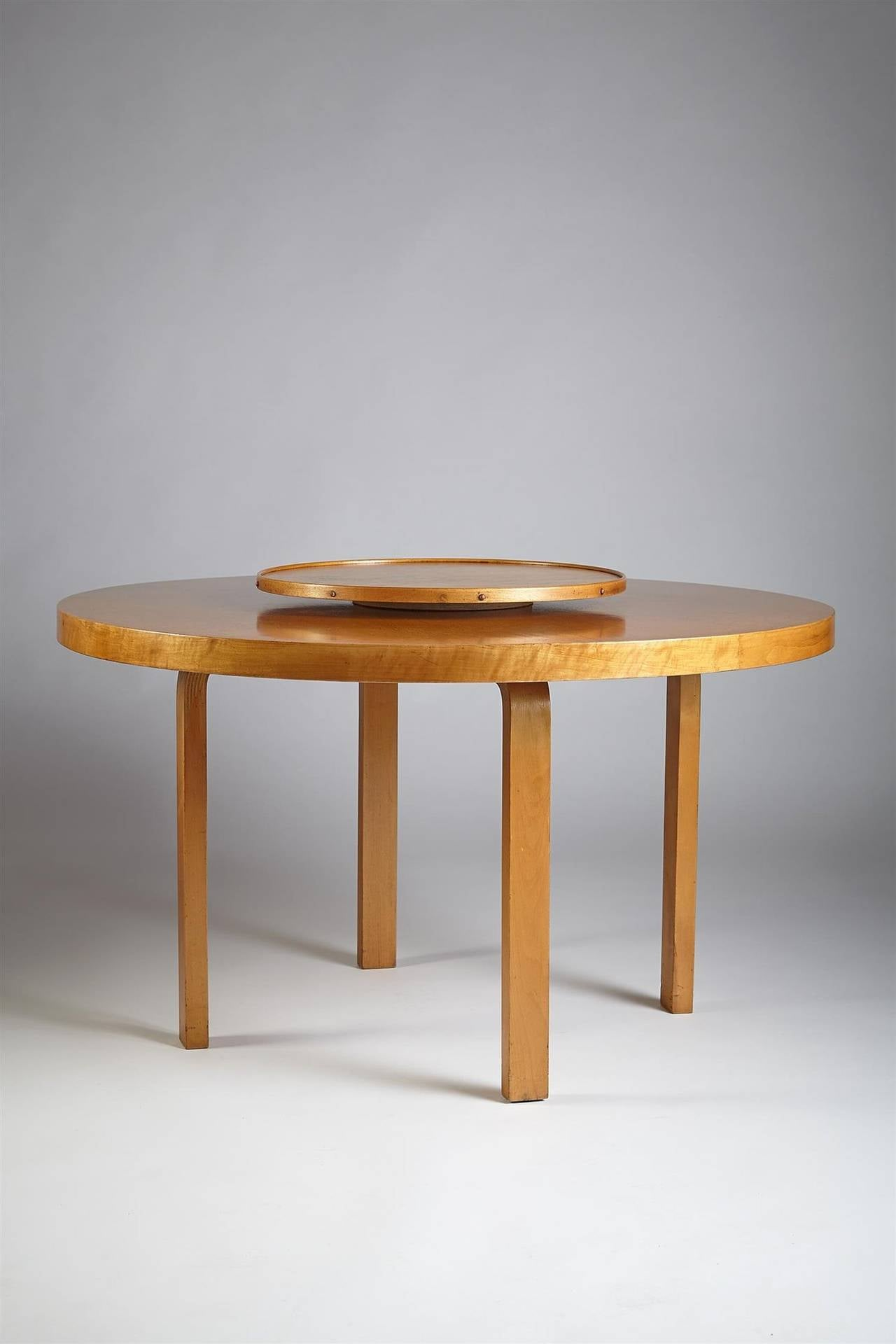 Dining table with carousel designed by alvar aalto for for Dining table design examples