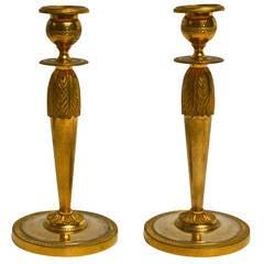 Pair of gilt bronze Empire French candlesticks signed Escalier De Cristal