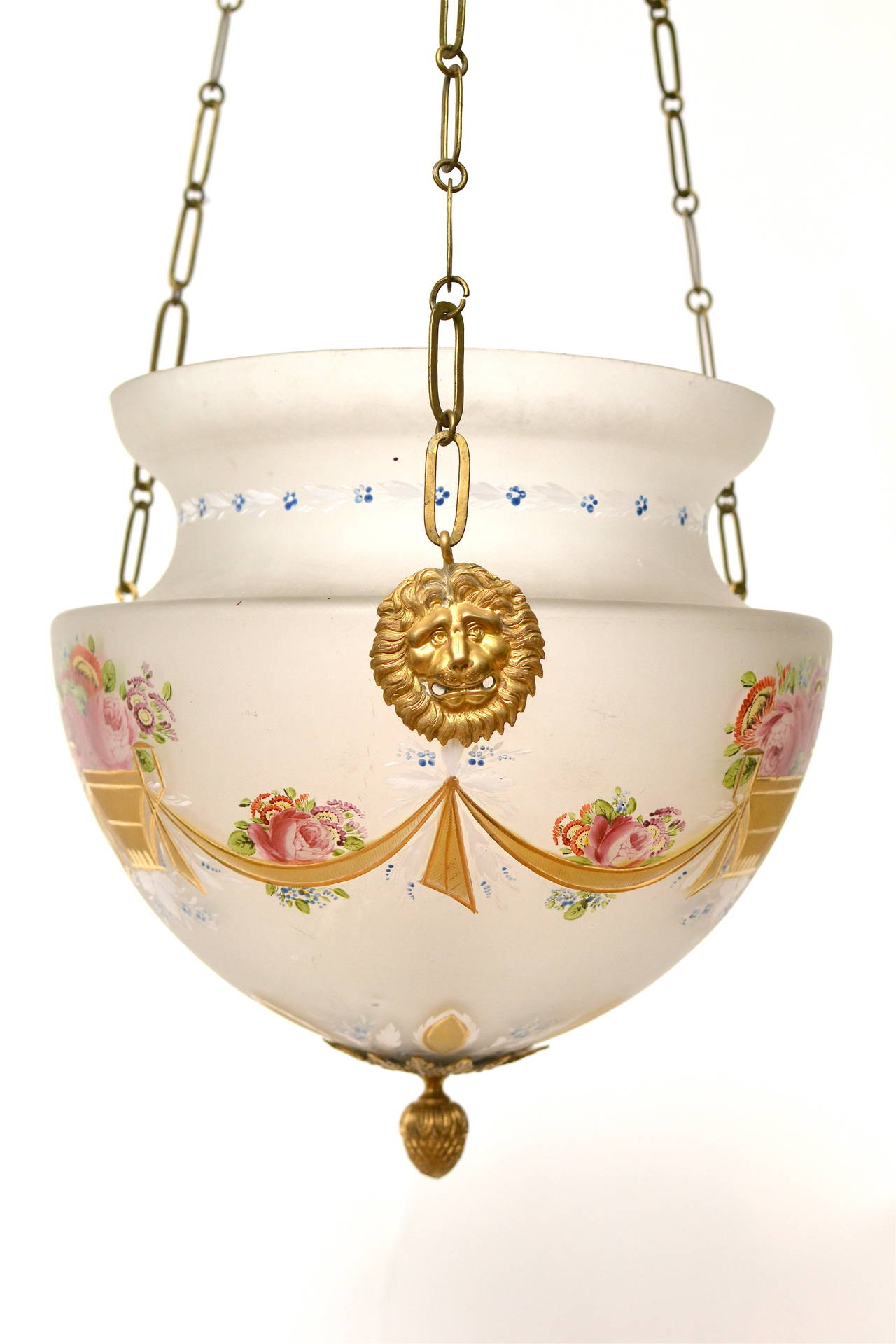 An Empire hanging glass lamp/lantern with gilt bronze mounts with one candleholder on the inside, early 19th century. The glass painted.