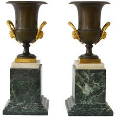 Pair of Empire Gilt and Patinated Bronze Urns on Marble Bases