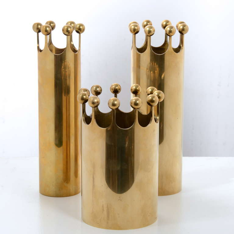 A set of vases in solid brass designed by Pierre Forsell for Skultuna, 1950s All three in difference sizes,  First pic from the left, Size: H 24 cm, D 6 cm H 17 cm, D 10  H 24, D 7.5 cm.