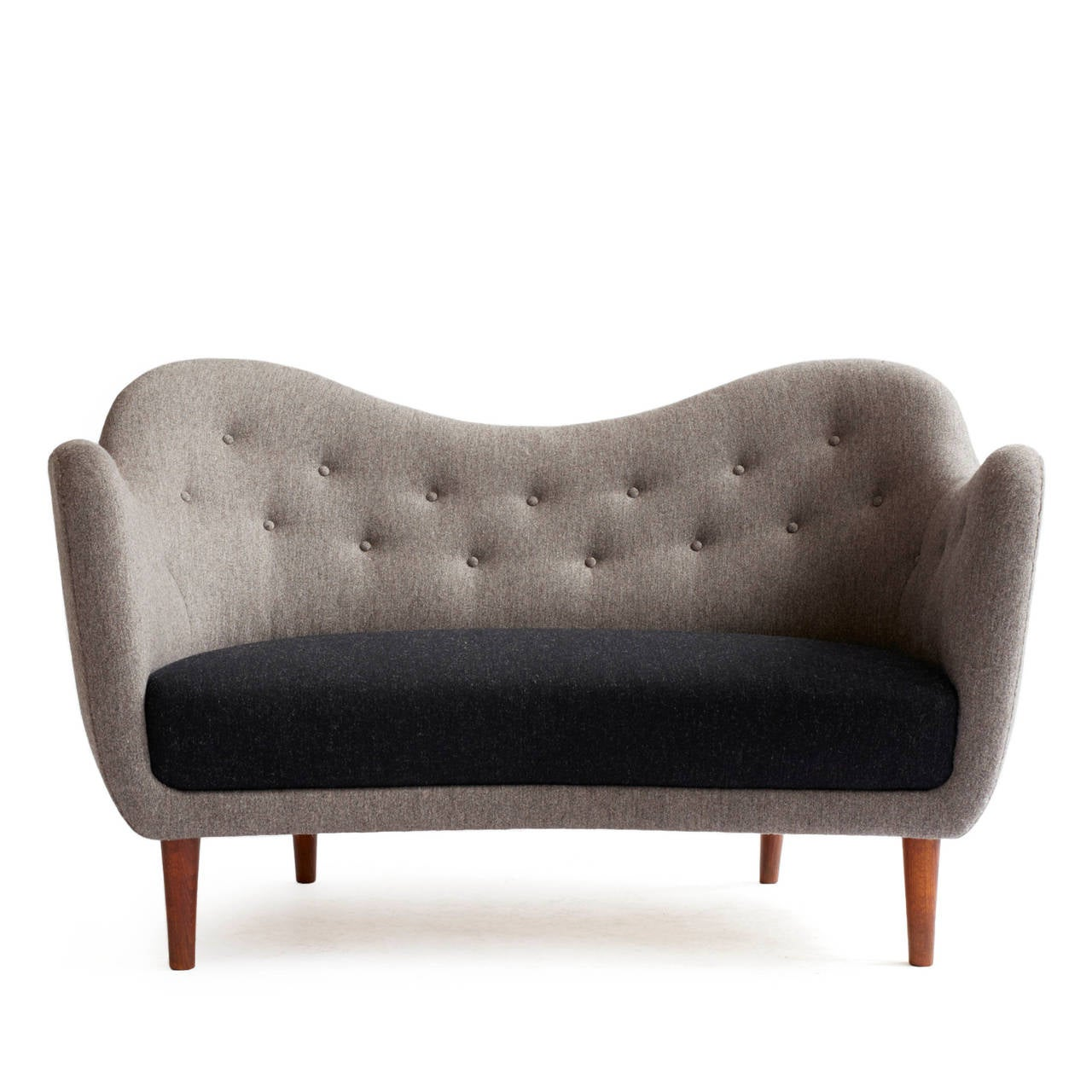 Finn Juhl two person sofa upholstered with two nuances of grey wool, tapering legs of stained beech. 