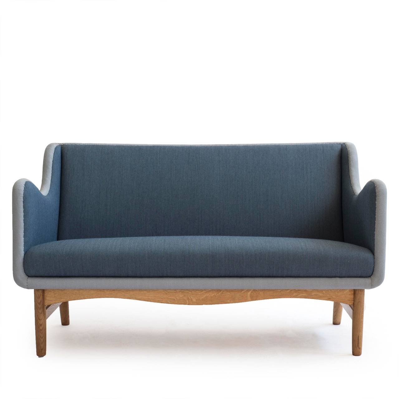 A little and beautiful Finn Juhl sofa with oak frame and two blue tone wool upholstery. 